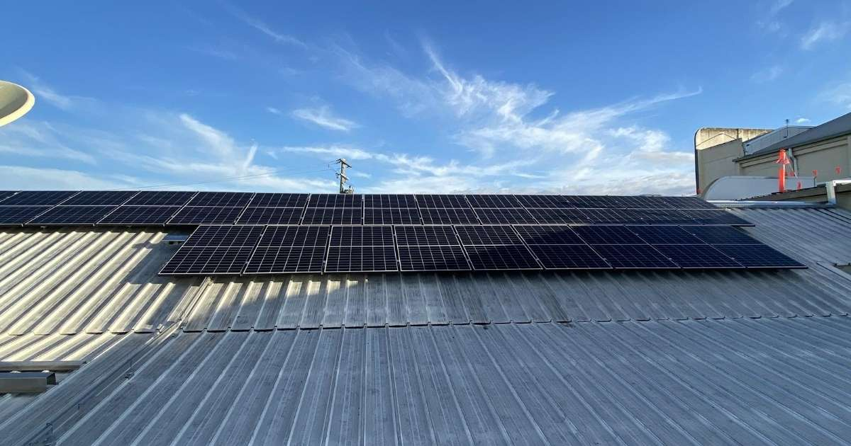 Cloudy blue sky and solar panels on commercial building